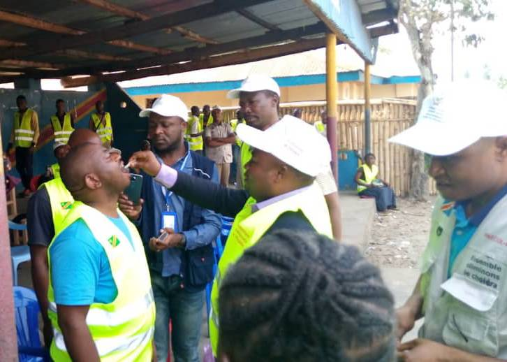 A local official receives a dose of oral cholera vaccine in Tshilenge, July 2019
