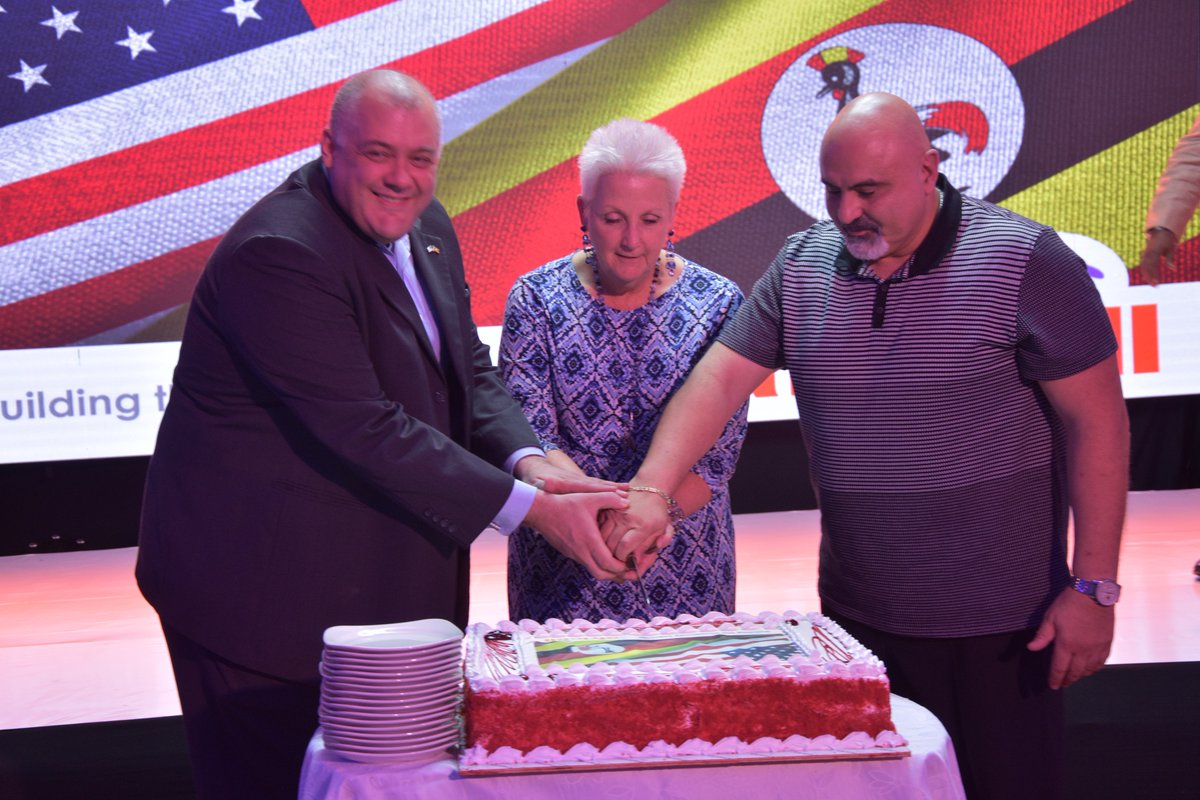 AMCHAM President Mike Davis (L), Ambassador Deborah Malac (M) and Africell CEO Ziad Daoud (R) cutting cake at the event on July 1