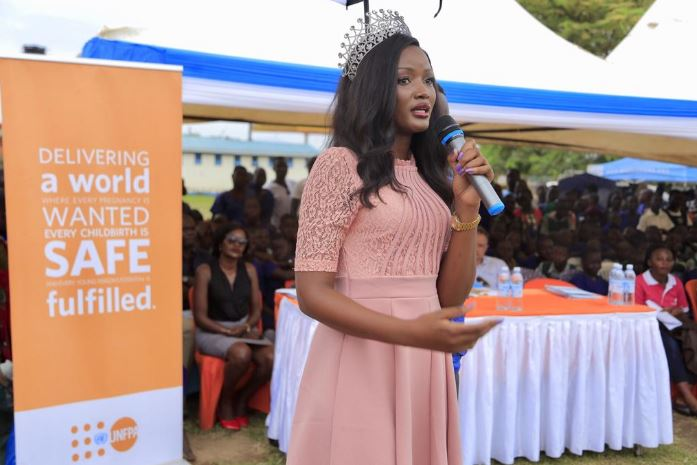 Miss Africa, also Miss Uganda, Quinn Abenakyo speaks to parents and children at GirlChild education intiative recently in Adjumani.  (PHOTO/ReachAHand)