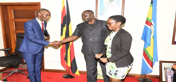 Deputy Speaker Jacob Oulanyah interacts with Pius Ngogi from Africa Management Services Company (AMSCO)