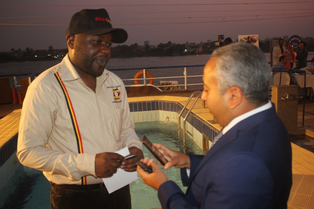 Eddie Kirya, a UTB board member interacts with an Egyptian journalist while on the cruise