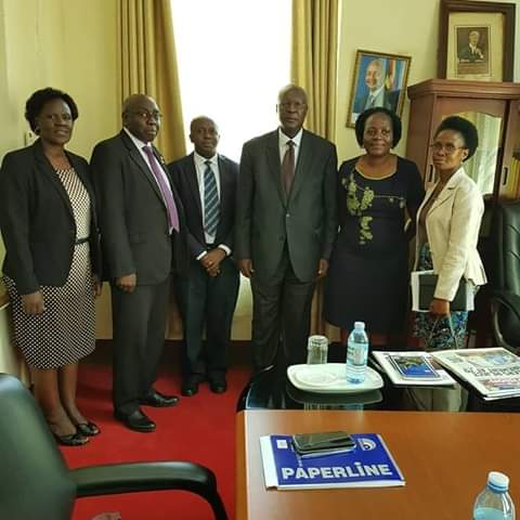 Chief Justice, Bart M. Katureebe shares a pictorial moment with a team from the Strengthening Uganda Government Anti-Corruption Response (SUGAR) on Friday July 19. (PHOTO/PML Daily)