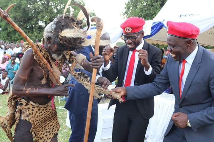 Kyadondo East Member of Parliament and People Power president Robert Kyagulanyi alias Bobi Wine and joyfully enjoy a traditional dance at a thanksgiving event of Kilak North MP Anthony Akol. (PHOTO/David Okema)