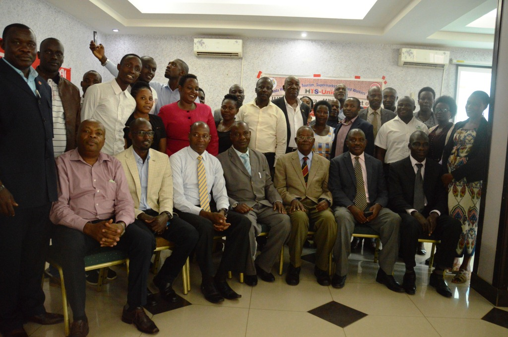 Hotel owners in a group photo with Minister Kamuntu at Oxford Hotel in Mbarara. (PHOTO/