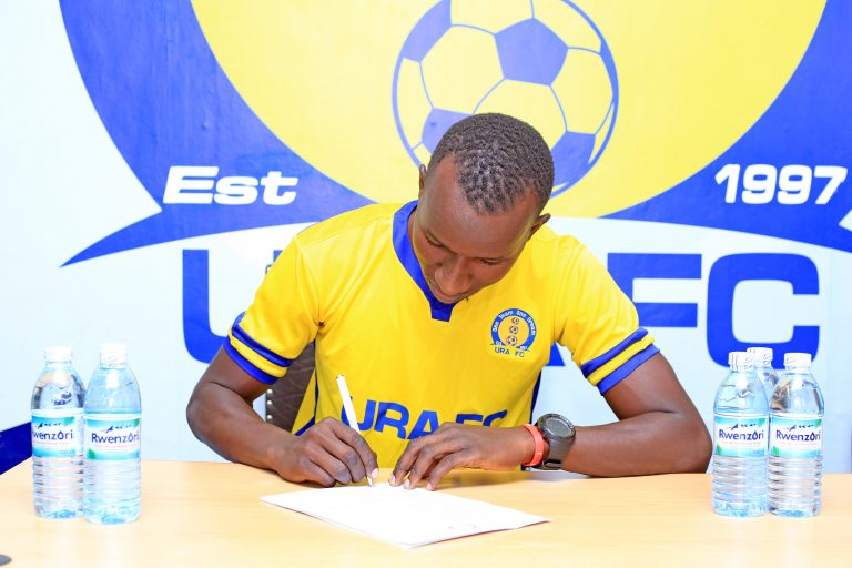 Ntege signing a three year deal at URA FC. (PHOTO/URA FC)