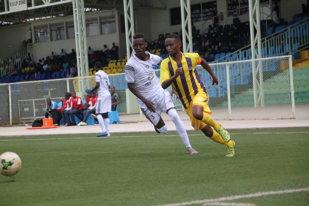 Proline FC captain Nordin Bunjo (right) in action against Heegan FC on Monday. (PHOTOS/Proline FC)