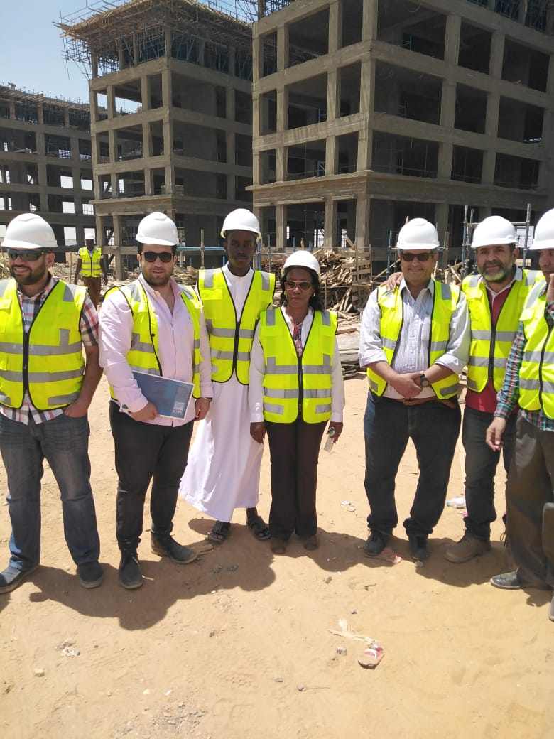 Minister Nakiwala Kiyingi (Center) taken around one of the Mac Optic construction sites in Cairo, Egypt. (PHOTO/Courtesy)