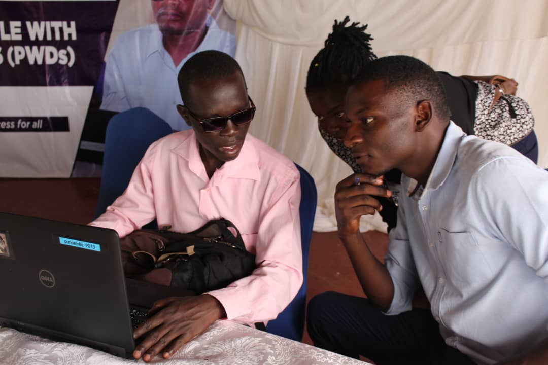 The blind computer expert Denis Kamakech and Javira Ssebwami at Greens Garden Hotel in Mbale last week. (PHOTO/John Vianney Nsimbe)