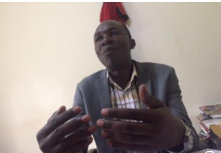 Mayor Njeru Municipality H/W Yasin Kyazze addressing the media in his office at Njeru Municipal town.