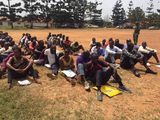 Some of the youths at the Mukono District grounds waiting for the documents to be verified