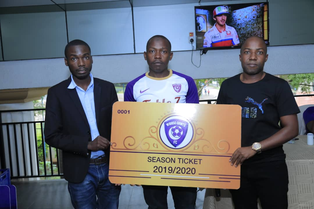 Wakiso Giants FC CEO Sula Kamoga (Left) and two other club officials pose with a Gold season ticket at Grand Imperior Hotal. (PHOTOS/ Wakiso Giants)