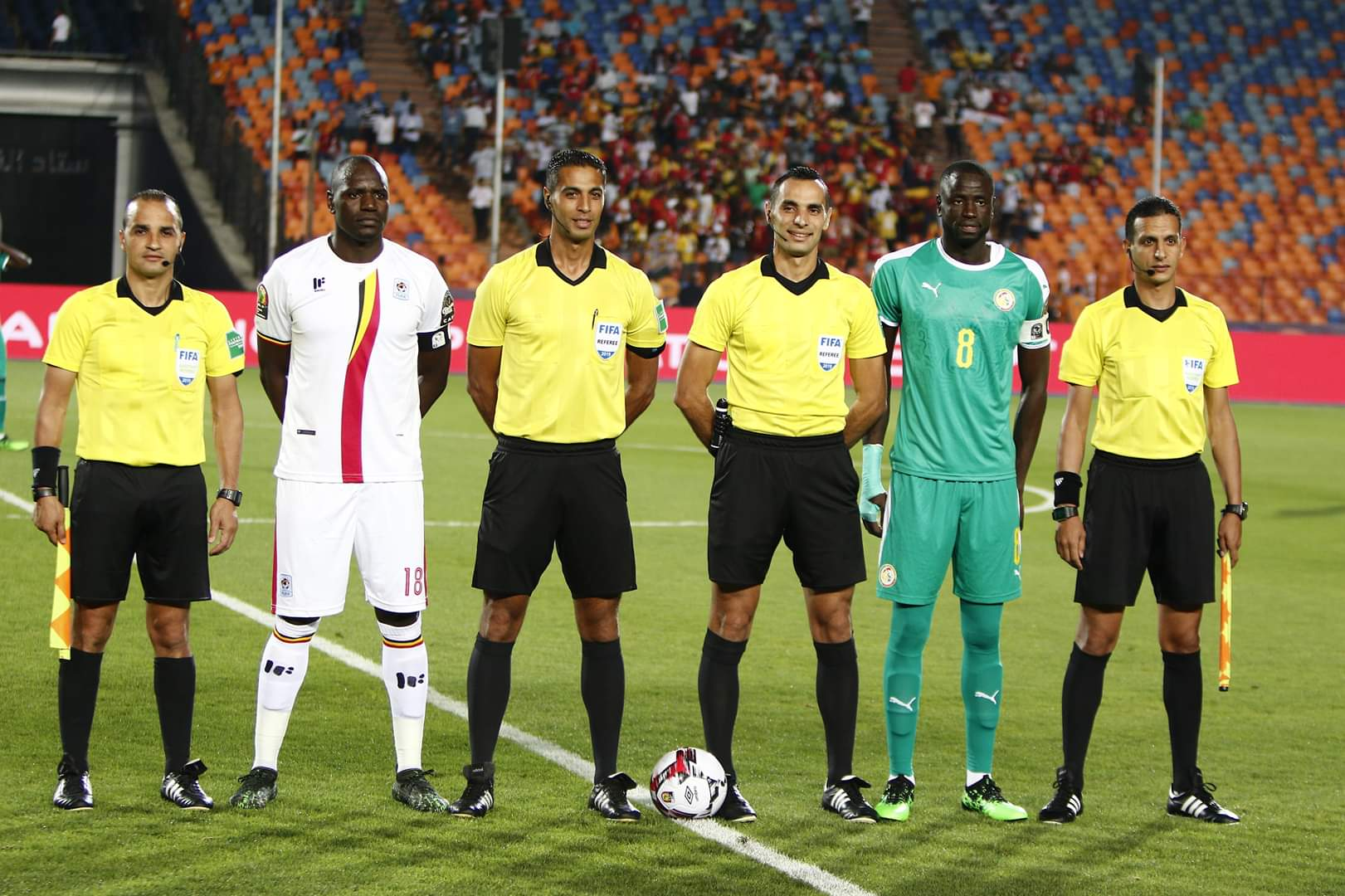 The two team captains line up alonside the referees before kick off on Friday.
