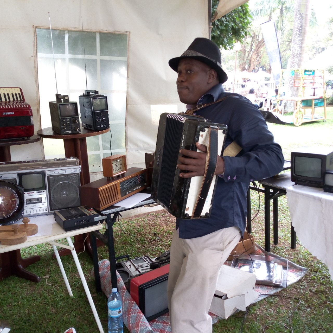 The overall winner for the Collectibles, Mr.Emmanuel Ssemwanga plays the Accordion at the 8th Vintage Auto Classic Show at Sheraton Hotel, Kampala on Saturday ,July 27. (PHOTO/Abraham Mutalyebwa)