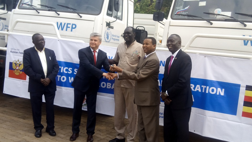 Russian federation ambassador to Uganda Alexander Polykov hands over trucks to WFP.