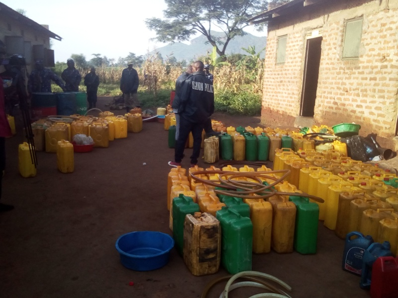 Impounded fuel being siphoned plastic tanks into jericans before they were transported to Tororo central police station.Photo by Joseph Omollo