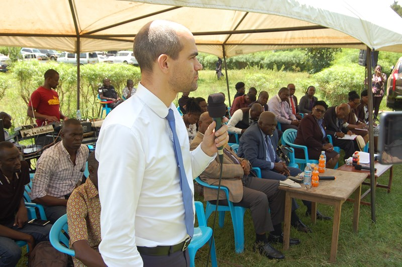 Mr. Jeans Michael Pons [CEO] Hima Cement makes his address before handing over consent of land ownership to the land owners on Wednesday. Photo by Joseph Omollo