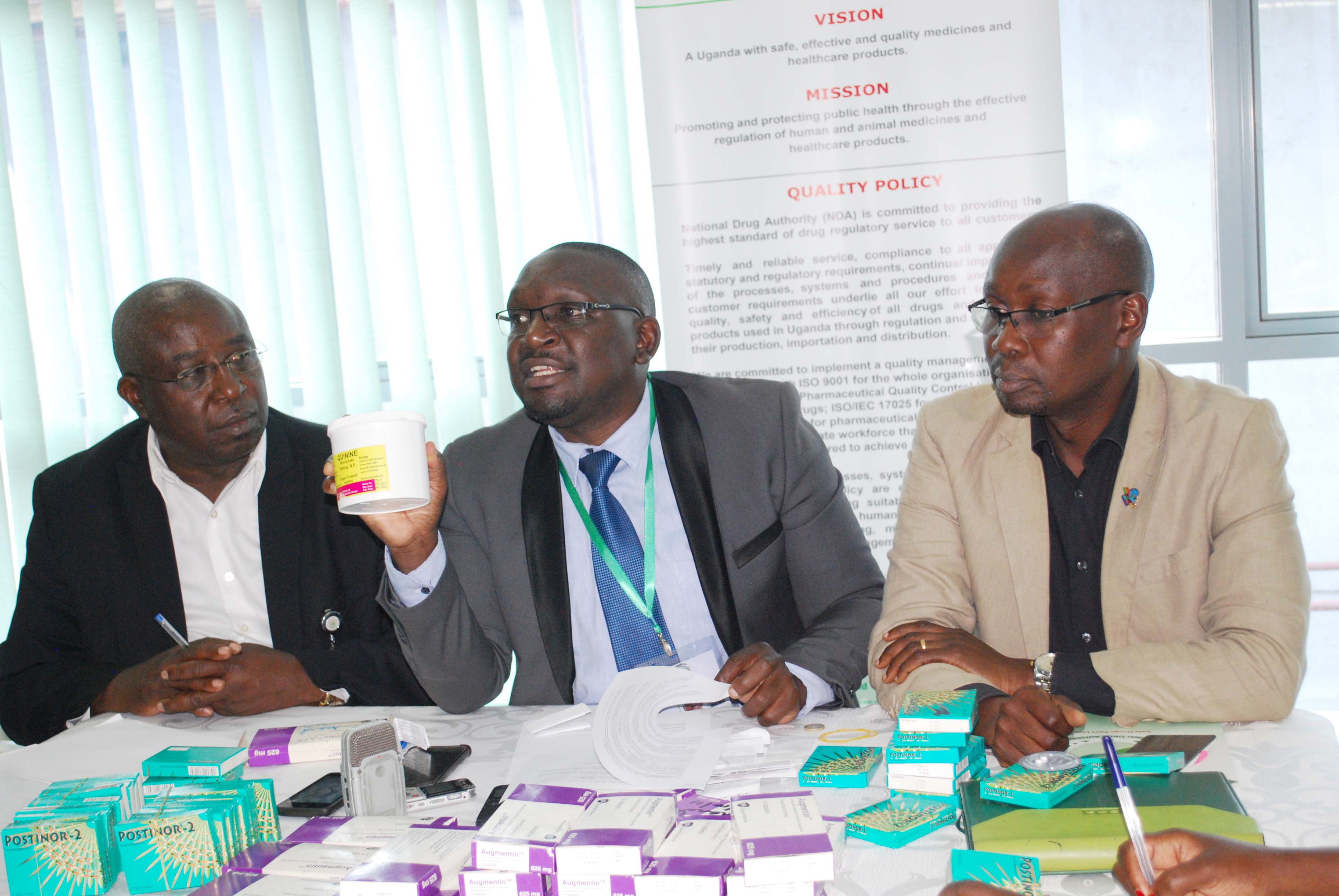 L - R . Mr .Samuel Kyomukama, head of Enforcement , Mr .Nasser Lubowa, Ag head of post market surveillance flanked by Frederick Ssekyana ,public relations officer as he displays the  Substandard and falsified drugs on the market. (PHOTO/ Abraham MUTALYEBWA)