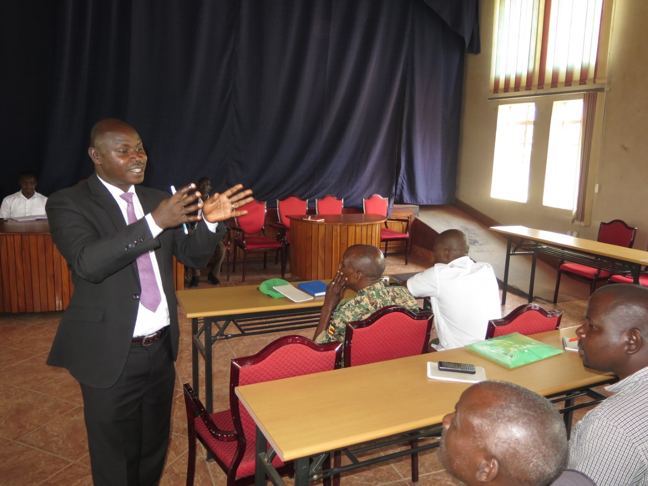 Ntungamo Deputy CAO Leonard Ahimbisibwe speaks to some of the officials. (PHOTO/Micha Kamusiime)