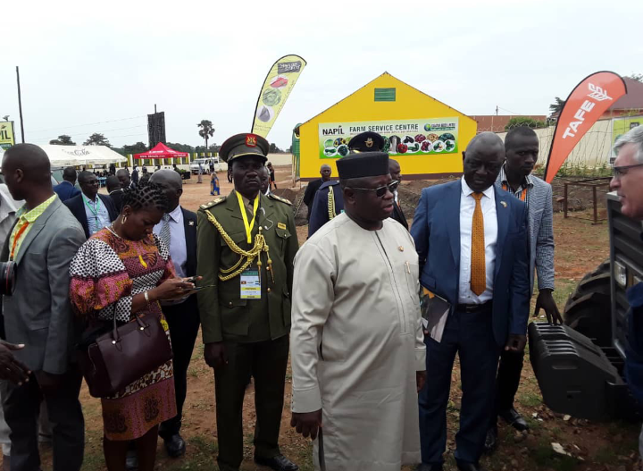 President Bio flanked by Uganda's Agriculture Minister Ssempijja in Nakaseke District. ( PHOTO/PPU)