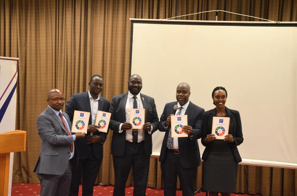 Guests pose for a group photo after the ULS President officially launched it today at Kampala Serena Hotel.