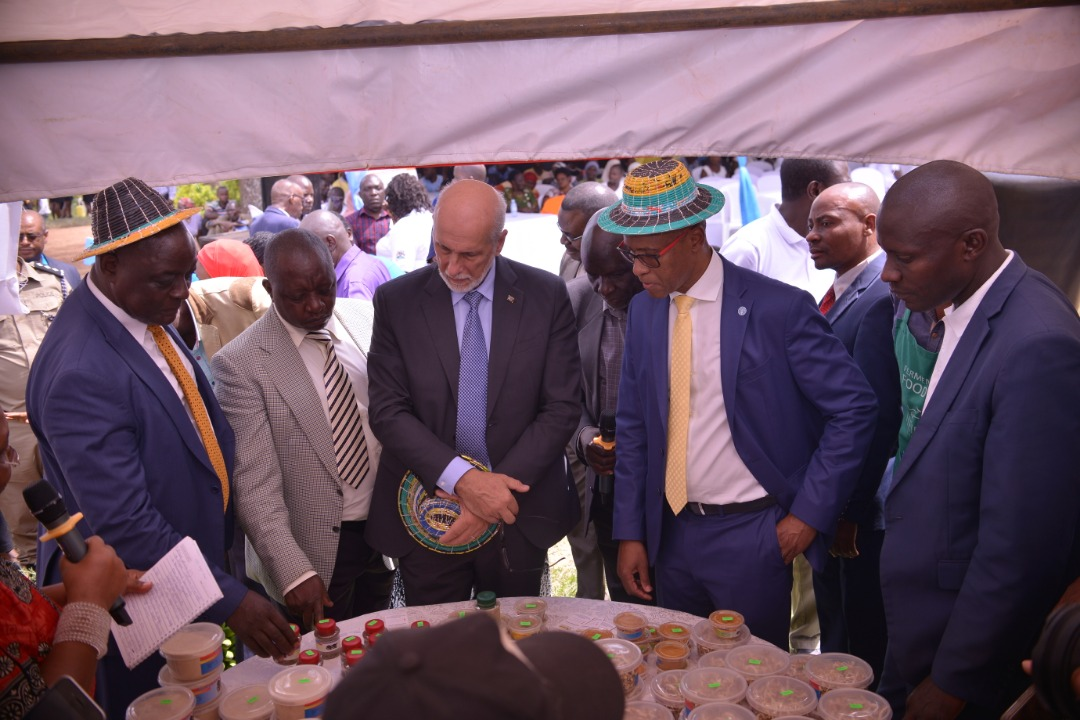 FAO Uganda Country Representative, Mr Antonio Querido, the EU Ambassador to Uganda, H.E. Attilio Pacifici, the Agriculture Minister, Hon. Vincent Ssempijja. visit one of the stalls at the launch in Kalungu. (PHOTO/FAO)