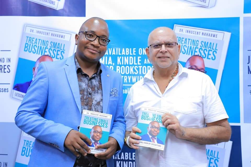 Book author, Dr. Innocent Nahabwe shares a pictorial moment with city businessman, Sudhir Ruparelia at the launch at Kingdom Kampala Friday July 12. (PHOTO/PML Daily)
