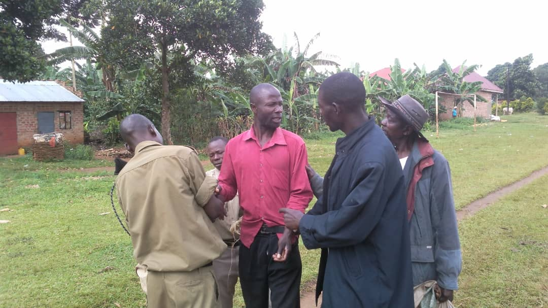 One of the residents getting arrested by the police for not having a pit latrine at his home. (PHOTO/File)