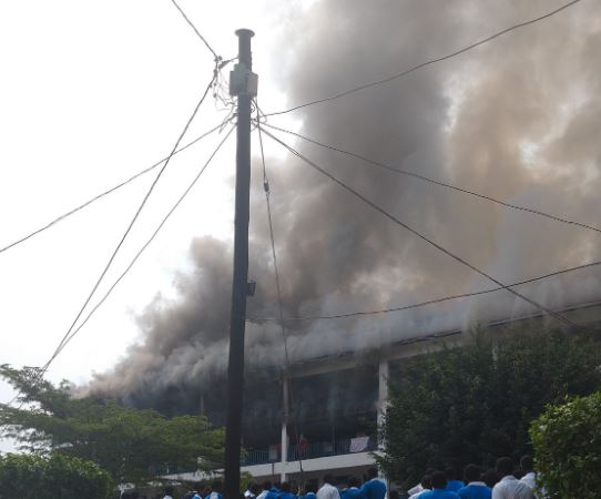 Smoke is seen ozzing out of the building as fire gutted the boys' dormitory at (PHOTO/Courtesy)