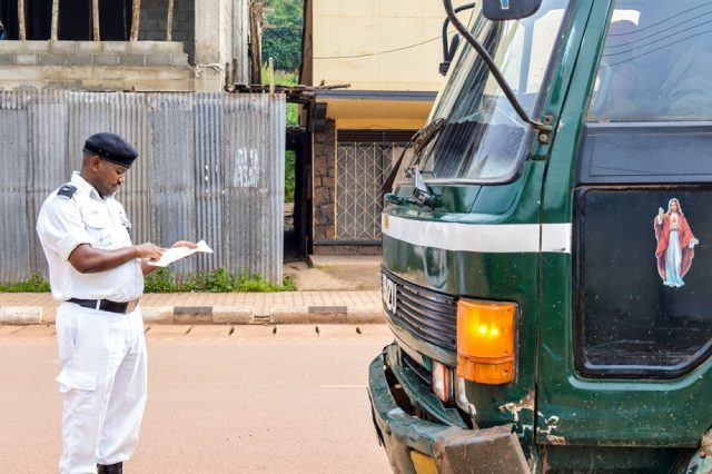 A Traffic Police officer slaps a truck driver with a traffic violations ticket. (PHOTO/File)