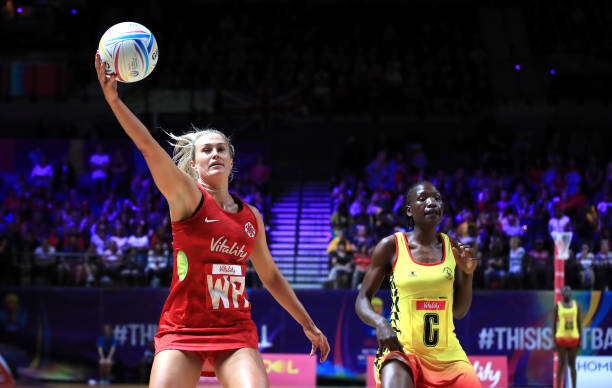England's Chelsea Pitman (left) and Uganda's Stella Nanfuka during the Netball World Cup match at the M&S Bank Arena, Liverpool. (Photo by Peter Byrne/PA Images via Getty Images)