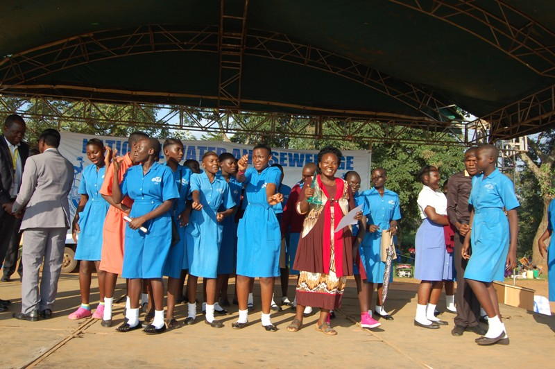 Students of Tororo Girls School with their patron jubilate after emeging the winners of school water and sanitation contest for Eastern region organized by NWSC at Uganda Technical College Elgon. (PHOTO/Joseph)
