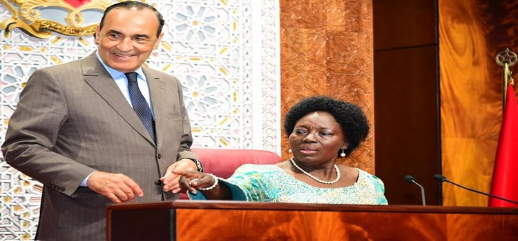 Kadaga(R) feels the chair of the Speaker of the House of Representatives of Morocco. Left is HE Habib El Maliki