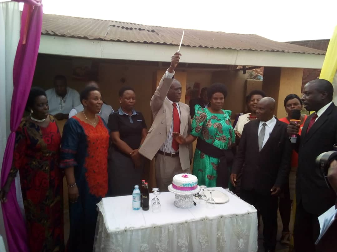 Beatrice Rwakimaari woman MP middle holding a knife is Odo Arigye