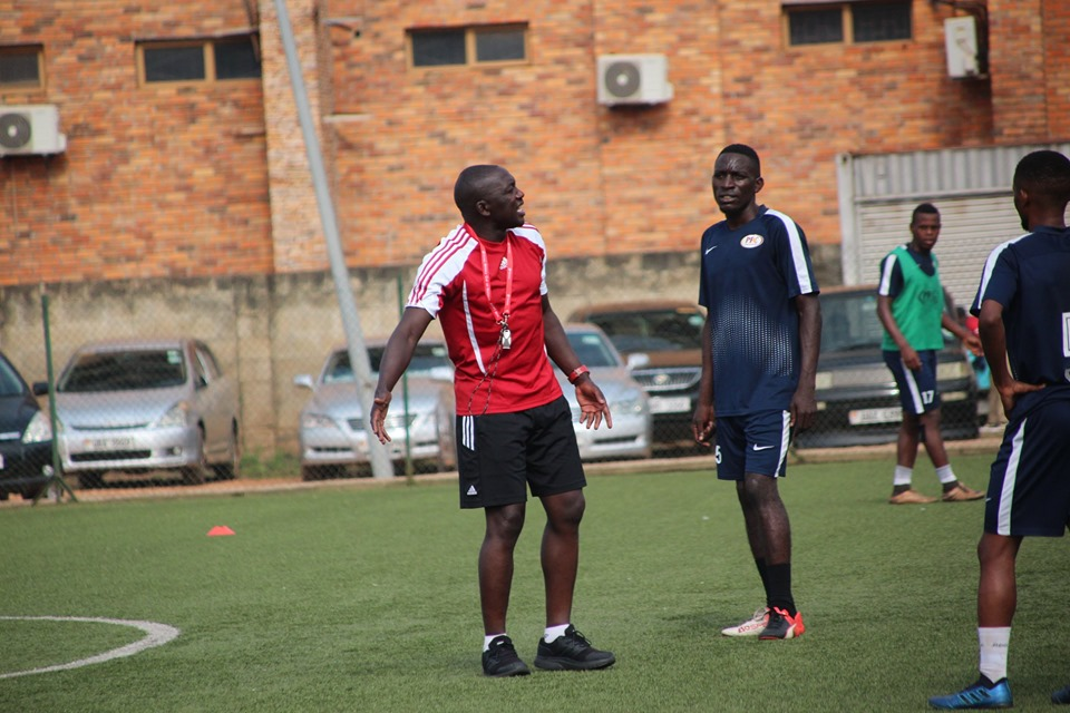 Lule (left) speaks to Bernard Buwanga at his first training session. (PHOTO/Proline)