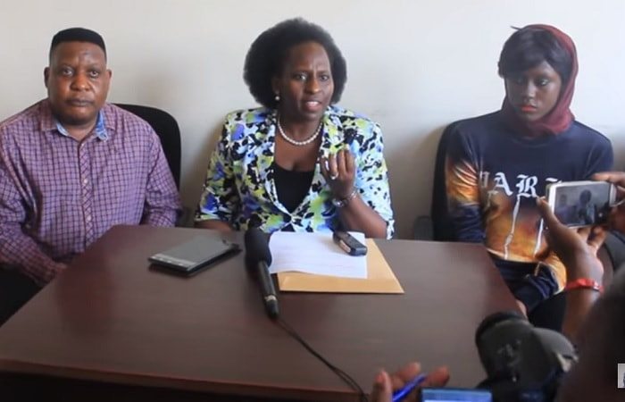 Sam Bagenda (Dr. Bossa) accompanied (R) Becky Juuko whose pics leaked a week back. In the middle is the PCC Chairperson Dr. Annette Kezaabu adressing the press