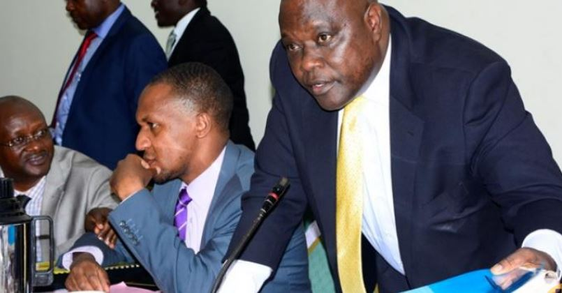 The State Minister for Transport Aggrey Bagiire submitting documents to parliament's physical infrastructure committee.