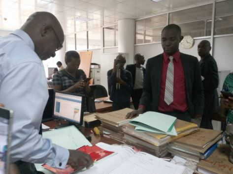 Mr Male Mabirizi in the High Court registry filing his three applications. Photo by Rachel Agaba.
