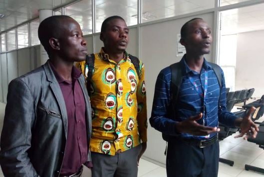 R-L Mr Arnold Mukose in charge of Human rights at  UJA, Hannington Kisakye of Smart 24 TV and  Eric Yiga of Salt Media at court. Photo by Rachel Agaba