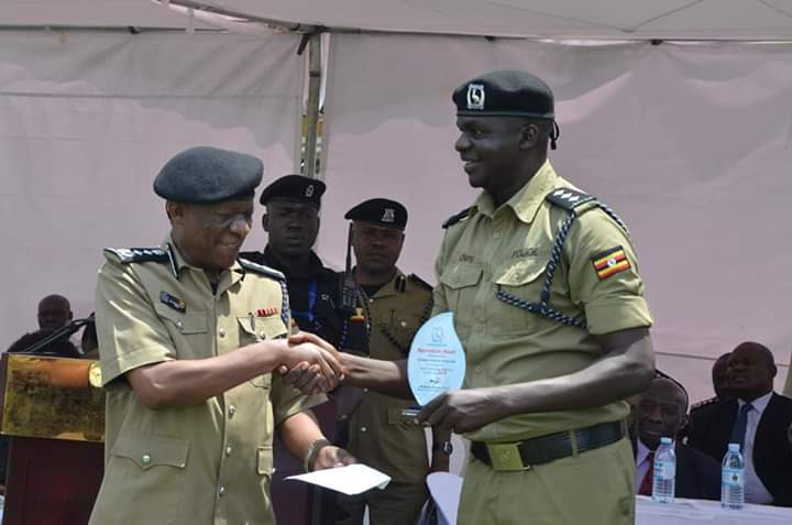 Inspector General of Police Martins Okoth Ochola awards the outstanding police commander for Yumbe. (PHOTO/Courtesy)