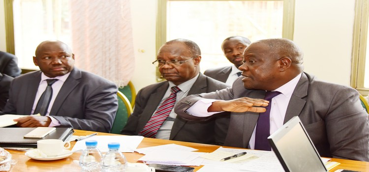 Hon Bagiire(R) appearing before the committee with other ministry official