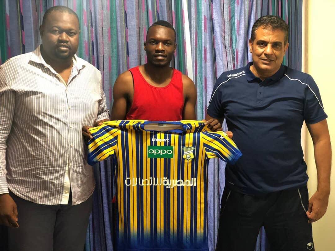 Tadeo Lwanga (center) posses with Tanta SC officials after signing for the club last year. (PHOTO/Courtesy)