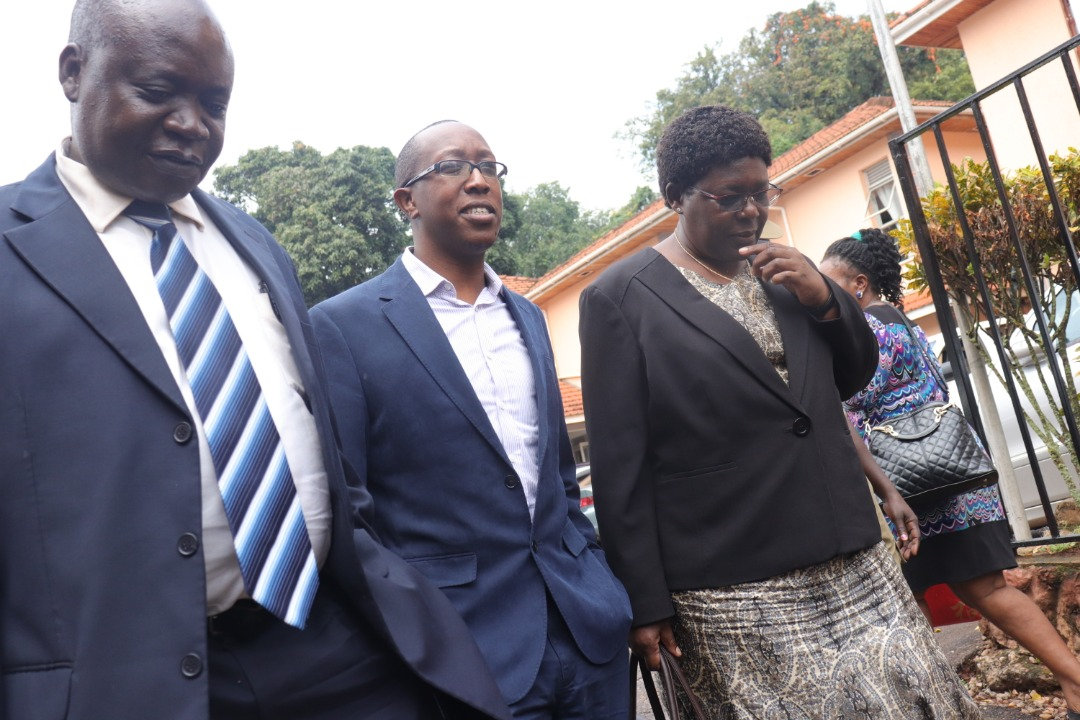R-L Dr Okiror , Commissioner Health Services Human Resource Management of Ministry of Health, Mr Cuthbert Kagabo the Deputy Director AH Consulting Limited and Dr Lukwago, secretary to Judicial Service Commission heading to the court cell. (PHOTO/ Rachel Agaba)