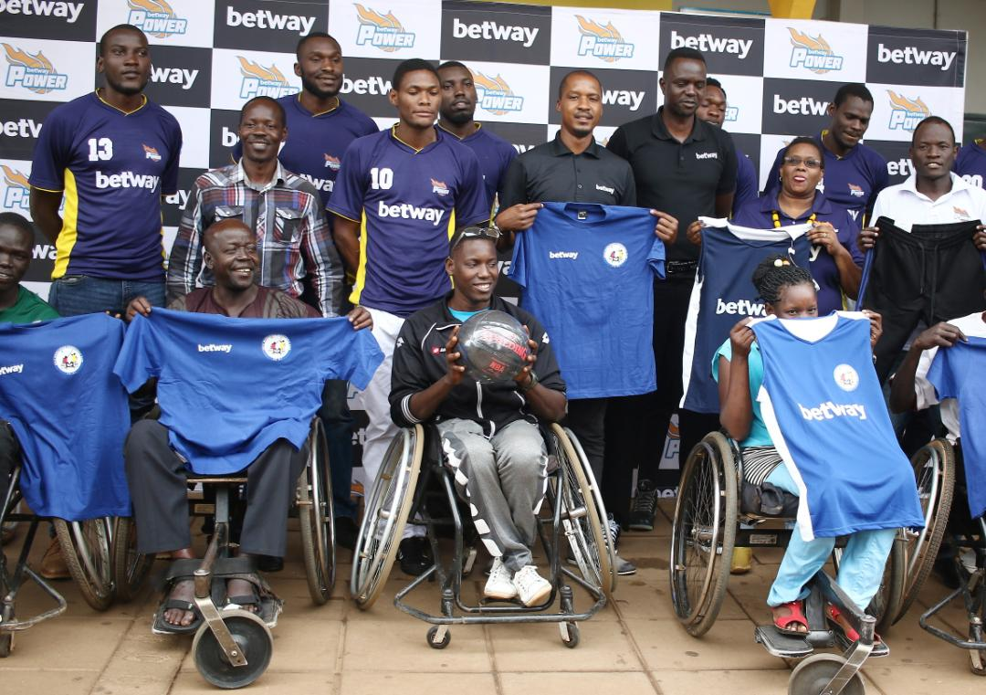 Betway official, Betway Power players and Gulu Hawks personnel pose for a picture on Friday. (PHOTOS/John Batanudde)