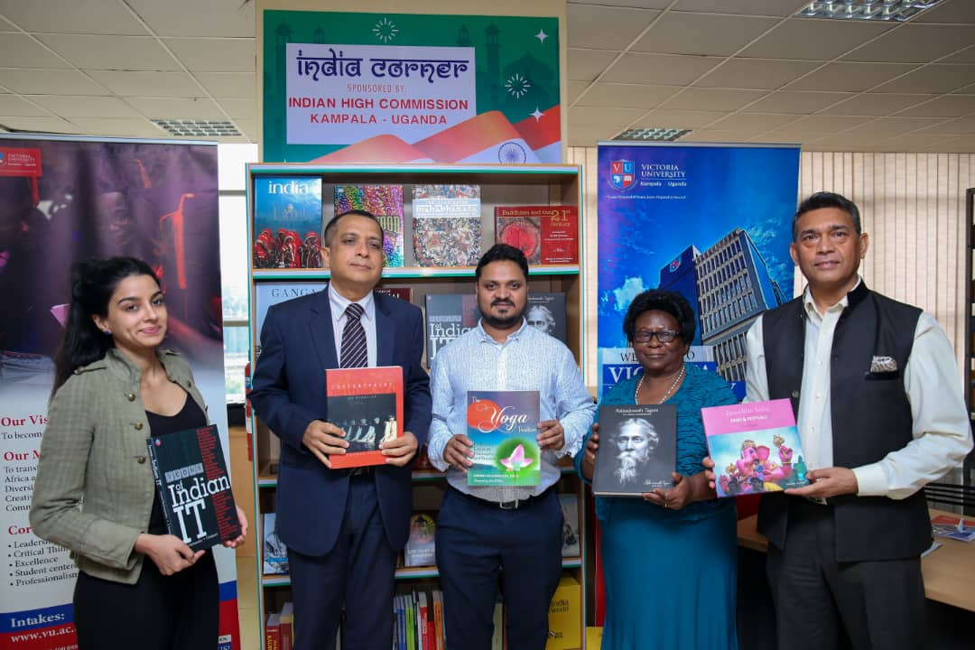 (L - R) Ms. Naiya Ruparelia, Indian High commissioner to Uganda, H.E Ravi Shankar, Vice Chancellor Victoria University, Dr. Krishna Sharma flanked by other officials displaying some of the reading materials that will be placed in the Libray  on Friday, August 9.( Photo/ Abraham MUTALYEBWA)