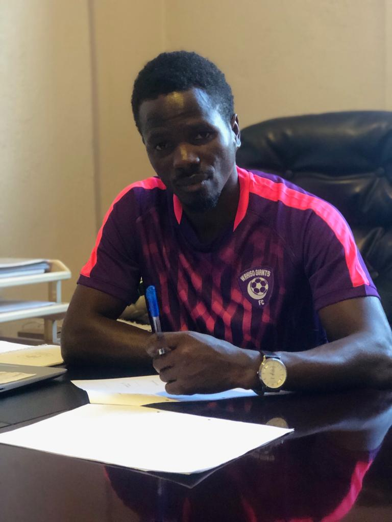 Sekajugo signing a three-year contract at Wakiso Giants, on Friday. (PHOTO/WAKISO)