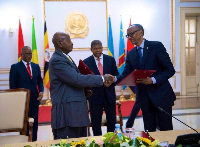 President Museveni shakes hands with President Kagame in Luanda, Angola (PHOTO/Courtesy)