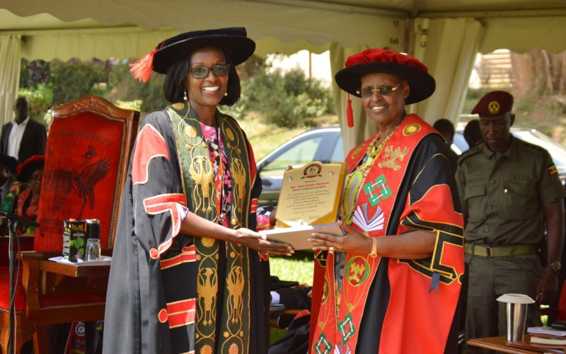The First Lady and Minister of Education and Sports, Hon. Janet Kataaha Museveni (Right) receives a plaque from the Chairperson Council, Mrs. Lorna Magara (Left) during Day1 of the 69th Graduation Ceremony, 15th January 2019, Makerere University, Kampala Uganda. (PHOTO/File)