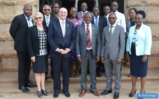 The Vice Chancellor, Prof. Barnabas Nawangwe (Centre) with the Vice Chancellor and President WSU, Prof. Barney Glover (2nd Left) flanked by (Front Row: L-R) Assoc. Prof. Linda Taylor-WSU, DVCAA-Dr. Umar Kakumba and Dean MakSPH-Prof. Rhoda Wanyenze as well as Staff from Mak and WSU