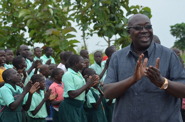Minister of defebse Okello Engola cheering pupils of Omer primary school in Amuru (2)