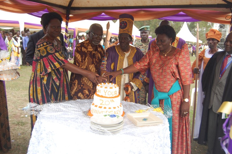 The 2nd deputy premier Mr. Kirunda Kevijinja and Kwar Adhola Moses Stephen Owori and Sarah Opendi cut the cake after the coronation anniversary. Photo by Joseph Omollo